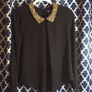 Gold collared black blouse